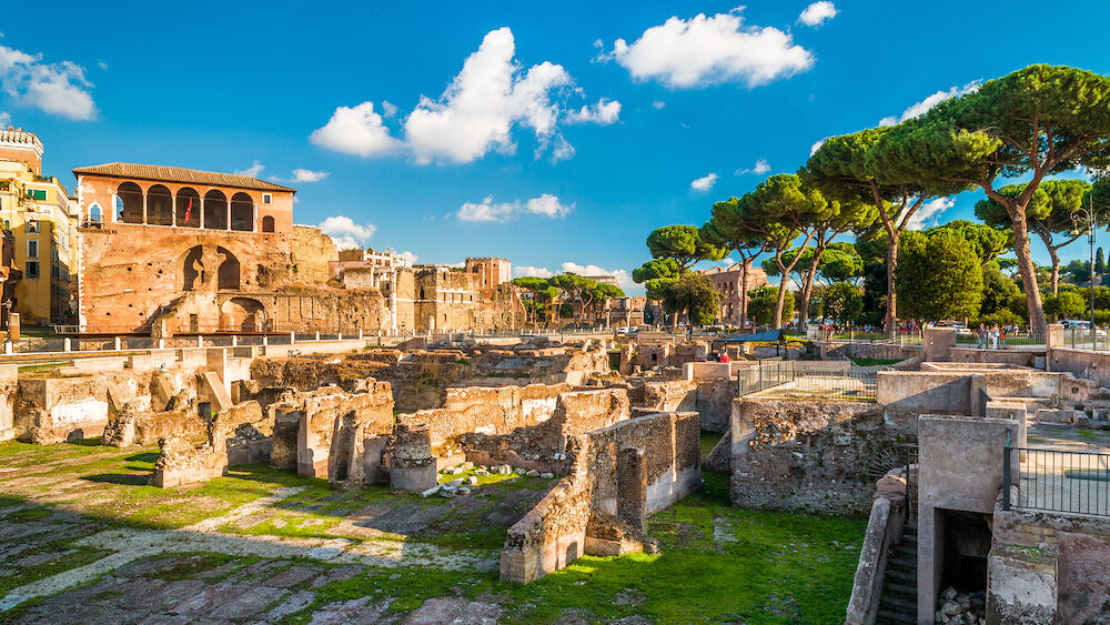 Panoramic view of Trajan's Forum in summer, Rome, Italy. Trajan`s Forum is one of main tourist attractions in Rome. Ancient Roman ruins in central Rome. Beautiful scenic panorama of Rome in sunlight.