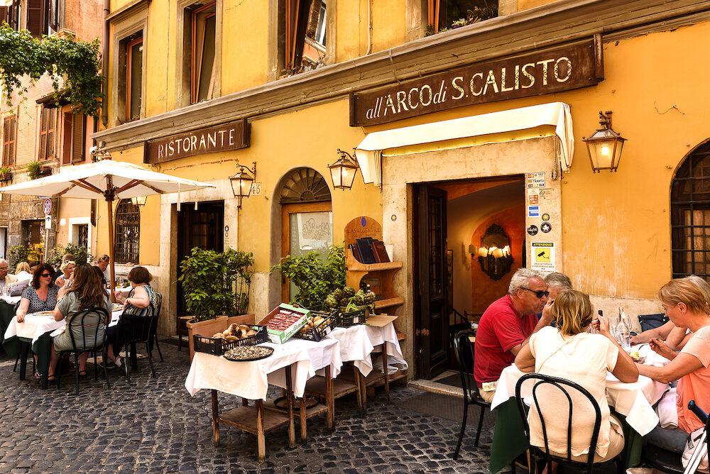 Rome Italy - Unidentified people eating traditional italian food in outdoor restaurant in Trastevere district in Rome Italy.