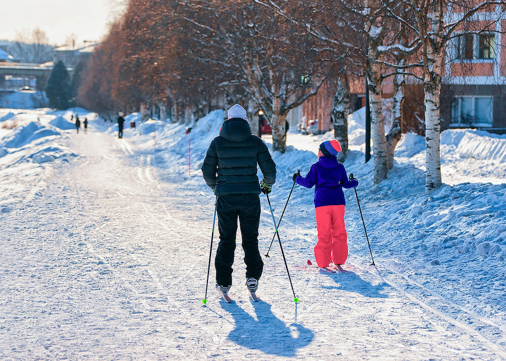Family of mother and daughter skiing in winter Rovaniemi Finland.