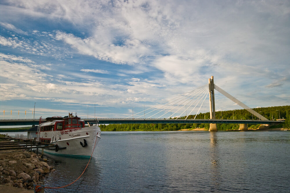 Rovaniemi/Finland -dusk view of the Rovaniemi Bridge and ferry boat