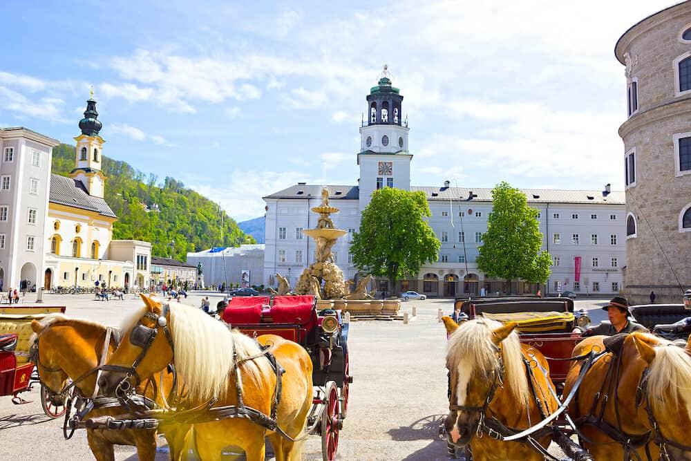 Salzburg, Austria - Central place in Salzburg city , Austria with carriages and horses at Salzburg, Austria
