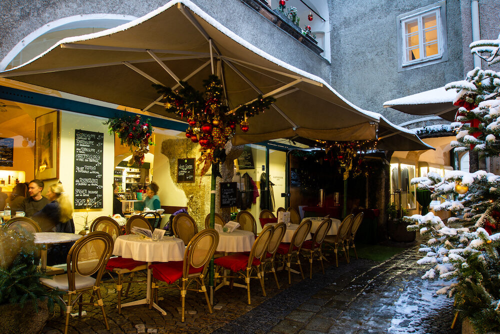 Salzburg, Austria- Patrons sit inside a restaurant enjoying lunch early in the afternoon