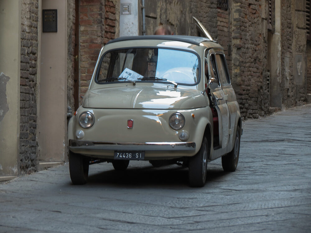 SIENA ITALY - CIRCA - Fiat 500 car station wagon with reversed doors