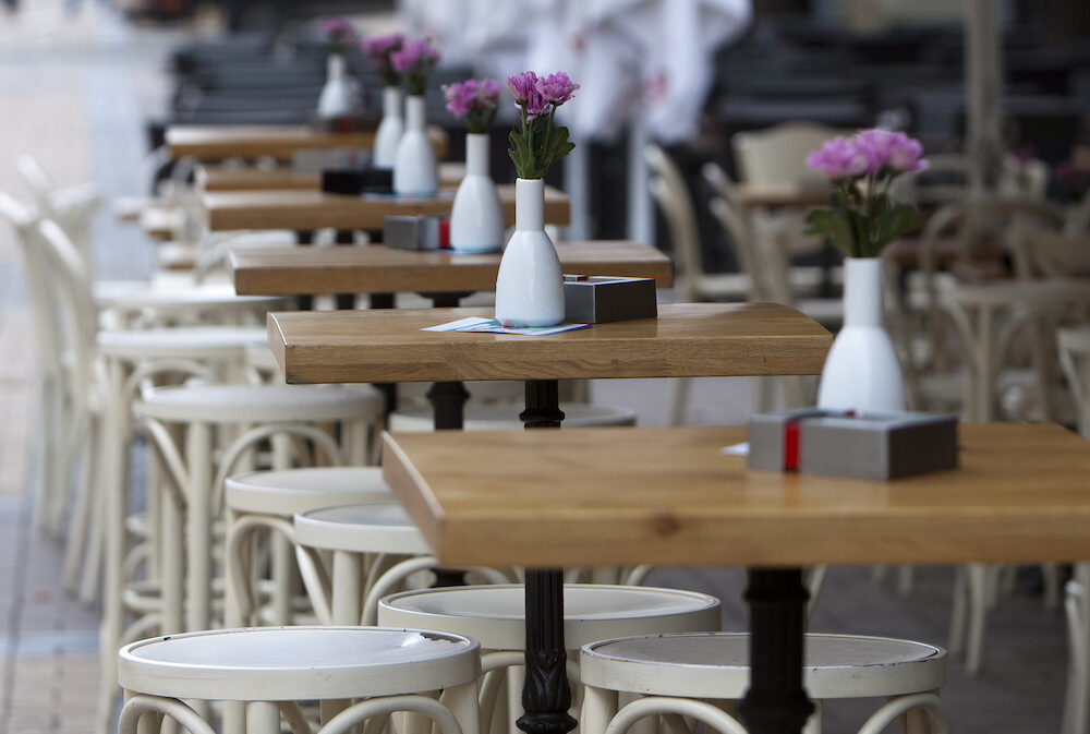 Cafe tables are seen in pedestrian street in Sofia Bulgaria.