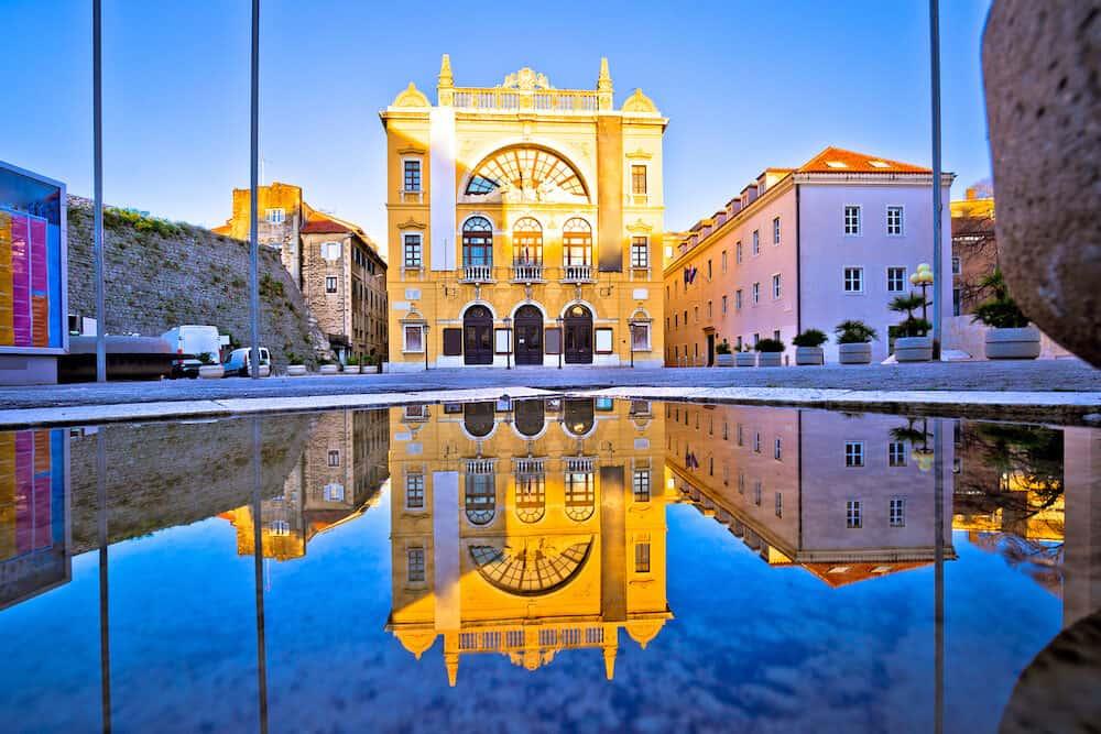 Croatian national theatre of Split water reflection view, Dalmatia region of Croatia