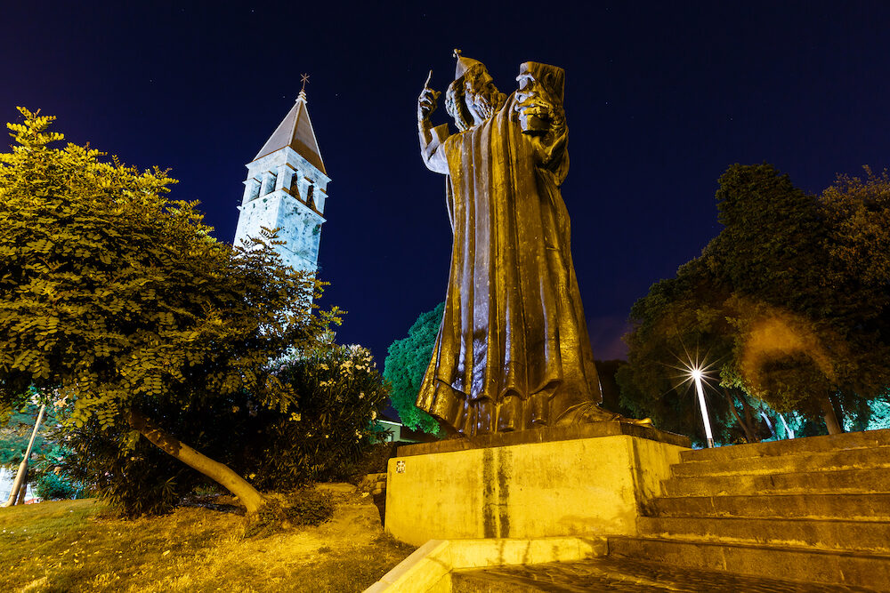 Gregory of Nin Statue and Bell Tower in Split at Night Croatia