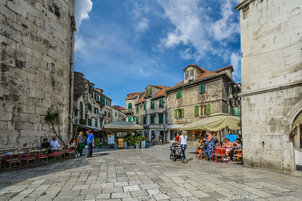 Split, Croatia -: Locals and tourists intermingle on a sunny morning in early autumn at the Fruit Square of Diocletians Palace in the ancient city of Split, Croatia.
