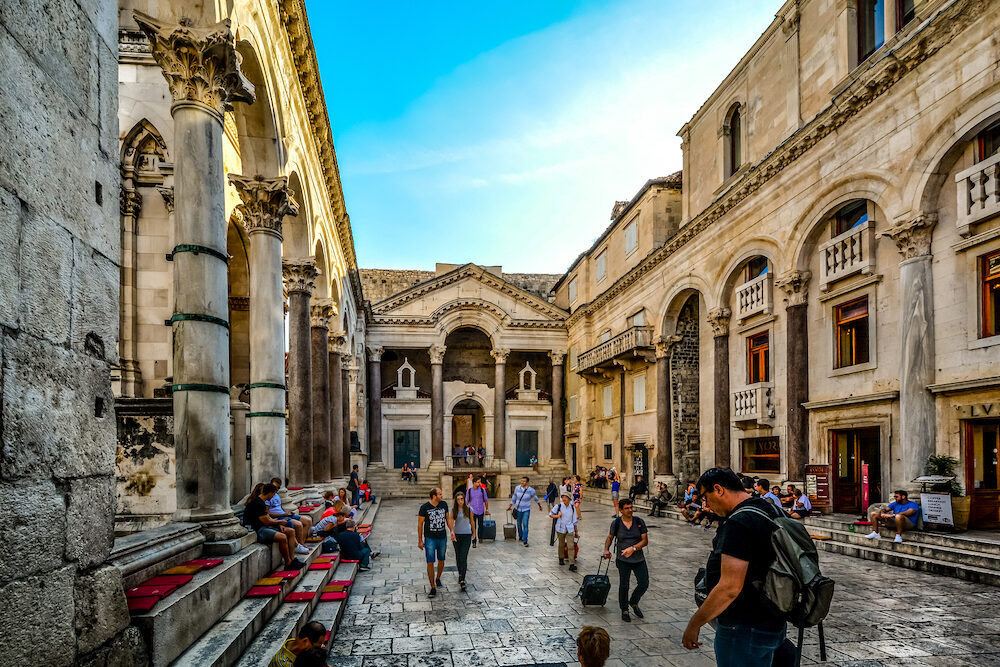 Split, Croatia - Tourists and locals enjoy an afternoon shopping and dining at the peristyle or peristil square inside Diocletians Palace in the old town section of Split Croatia