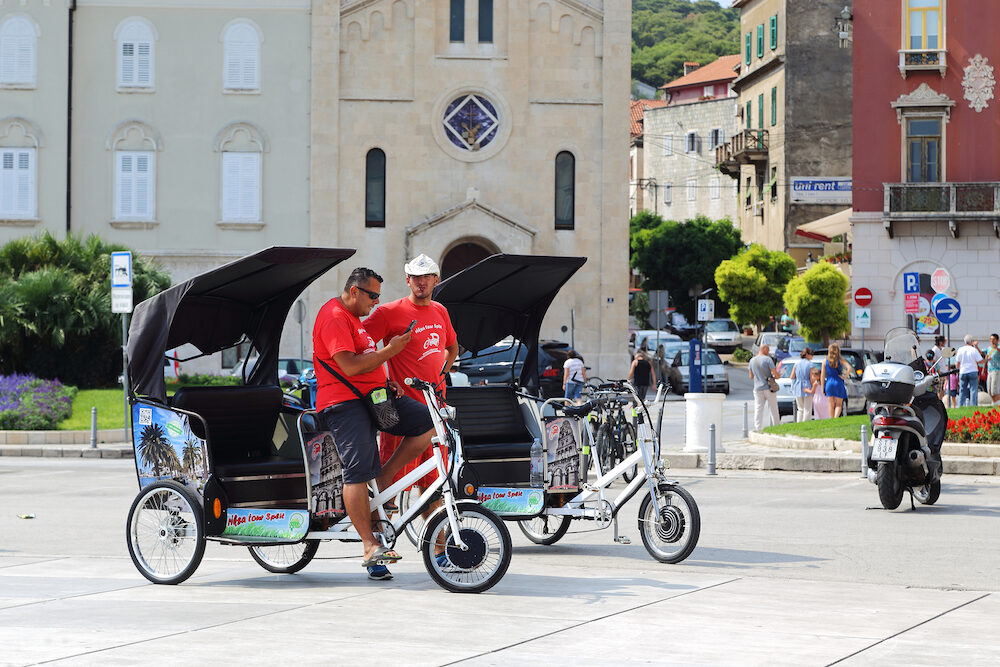 SPLIT, CROATIA - Unidentified trishaws wait for the wish to perform a bike tour around the city.