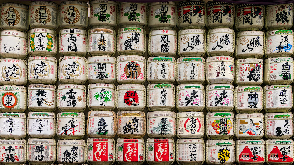 Tokyo, Japan - Barrels with sake were donated as a gift to Meiji Shrine from a different Japan breweries. These barrels have got a special name komokaburi.