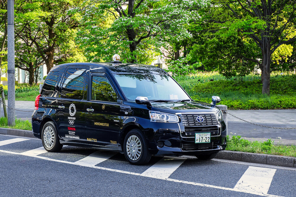 TOKYO, JAPAN - New model of Japanese Taxi called JPN Taxi prepares for Olympic 2020 tourism boom with accessible cabs and international drivers