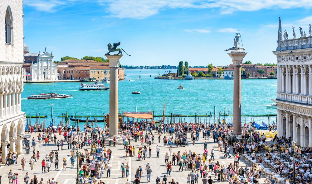 Venice, Italy - People visit the embankment at the Piazza San Marco in Venice. This place is a top tourist attraction of Venice. Concept of traveling and vacation in summer Venice.