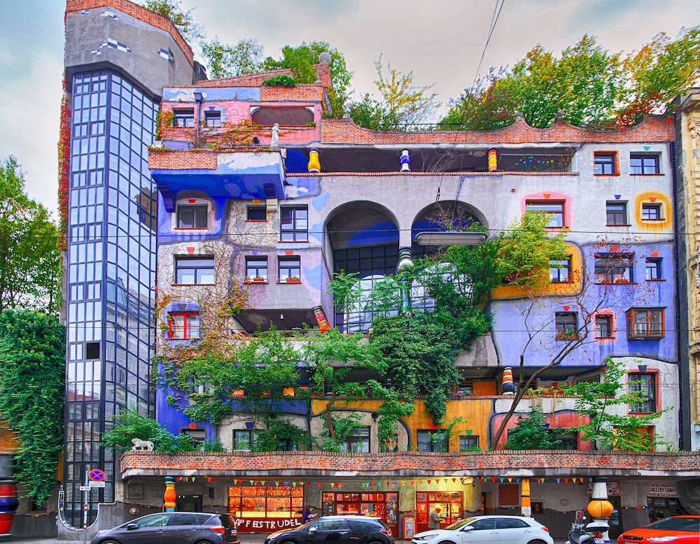VIENNA, AUSTRIA - Hundertwasser house, Hundertwasserhaus - apartment house, idea and concept of Austrian artist Friedensreich Hundertwasser. Colorful facade with growing trees, Autumn
