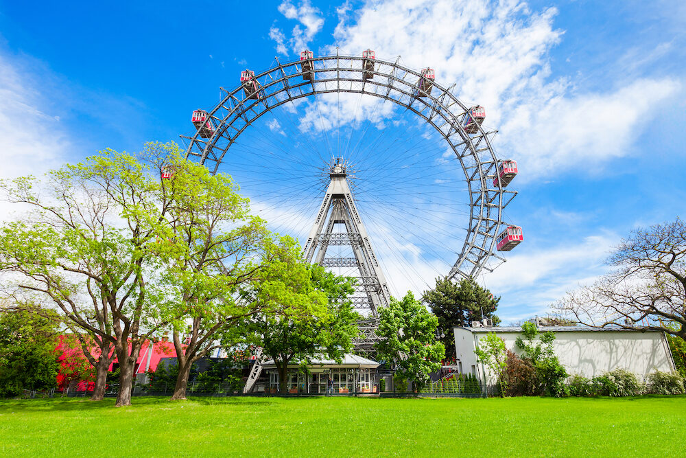 The Wiener Riesenrad or Vienna Giant Wheel 65m tall Ferris wheel in Prater park in Austria, Vienna. Wiener Riesenrad Prater is Vienna's most popular attractions.