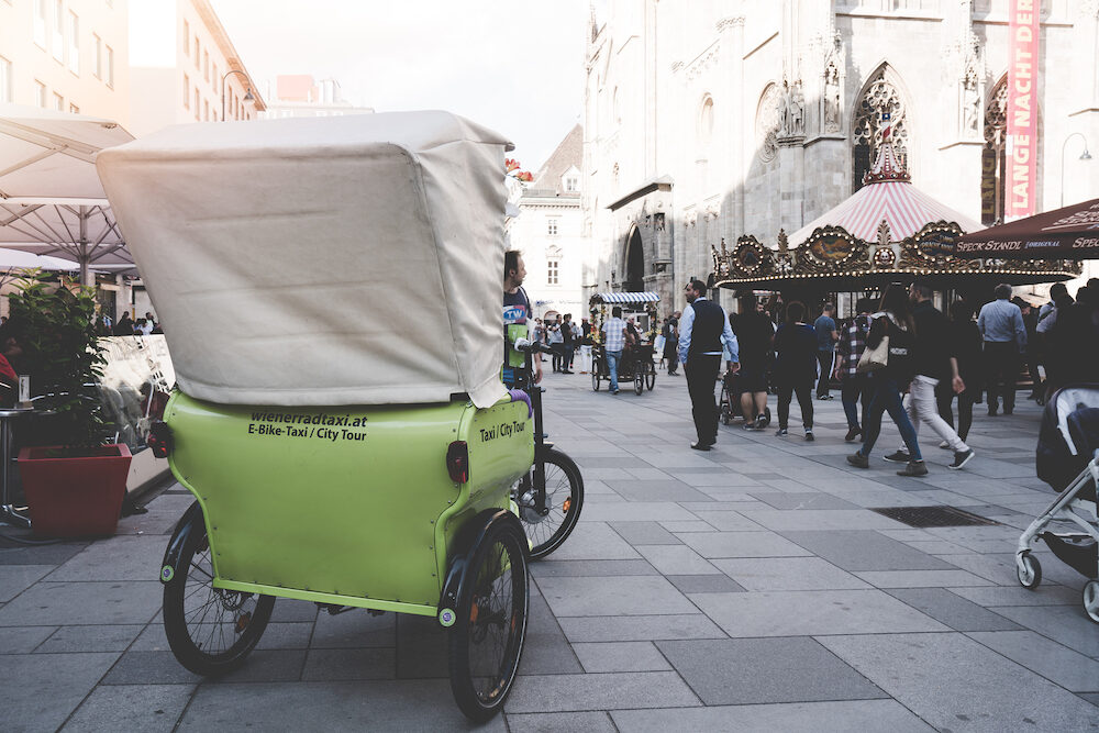 VIENNA, AUSTRIA - Tricycle or E-Bike taxi service for tourist and local people in stall street market at Vienna Austria.