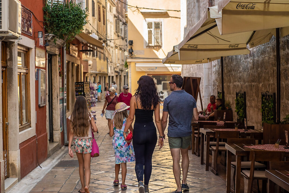ZADAR, CROATIA - Family walking in the ols streets of Zadar, Croatia.