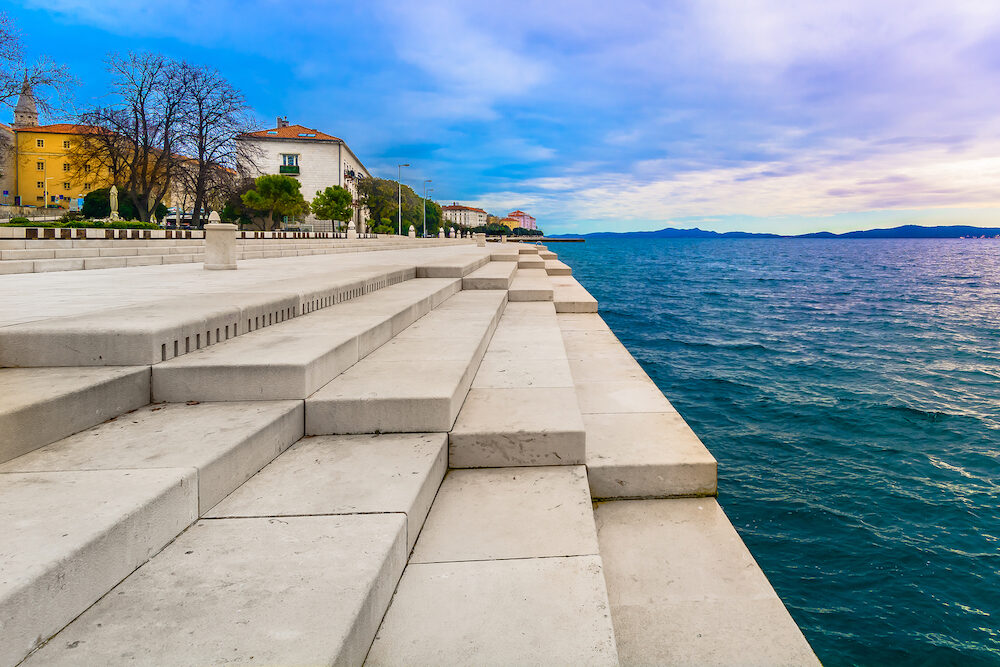 Scenic view at coastal town Zadar and famous landmark on city promenade, Sea Organ, Croatia Europe.