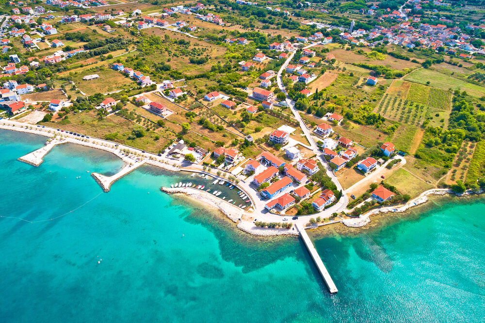 Zaton emerald beach and harbor aerial view, Dalmatia region of Croatia