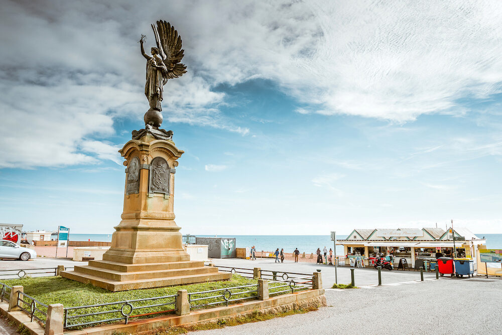 Brighton, England- The Angel statue monument stands on the Brighton and Hove Boundary representation of peace. The peace statue at seafront.