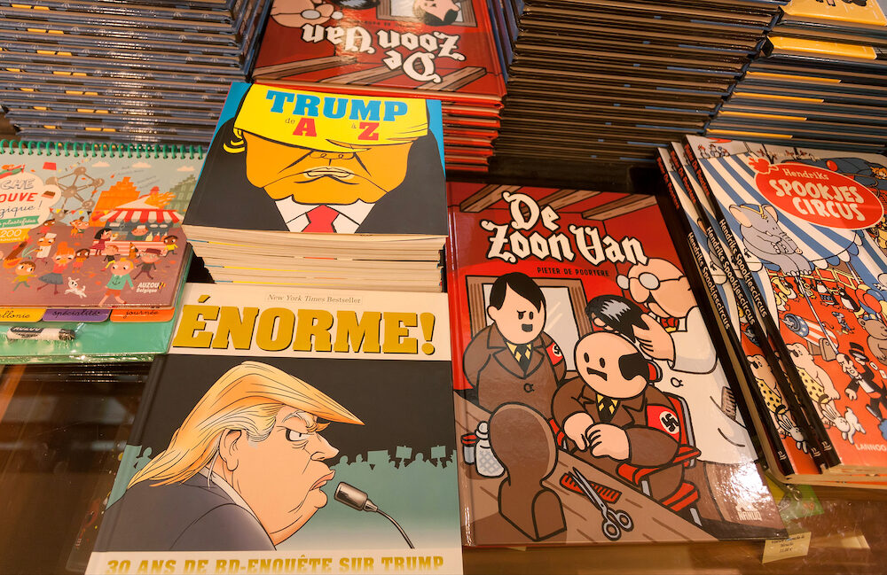 BRUSSELS, BELGIUM - Magazines and comics with funny books about USA president Trump and Hitler in Museum of Comic and Cartoon Art. More than 1,200,000 people lives in Brussels