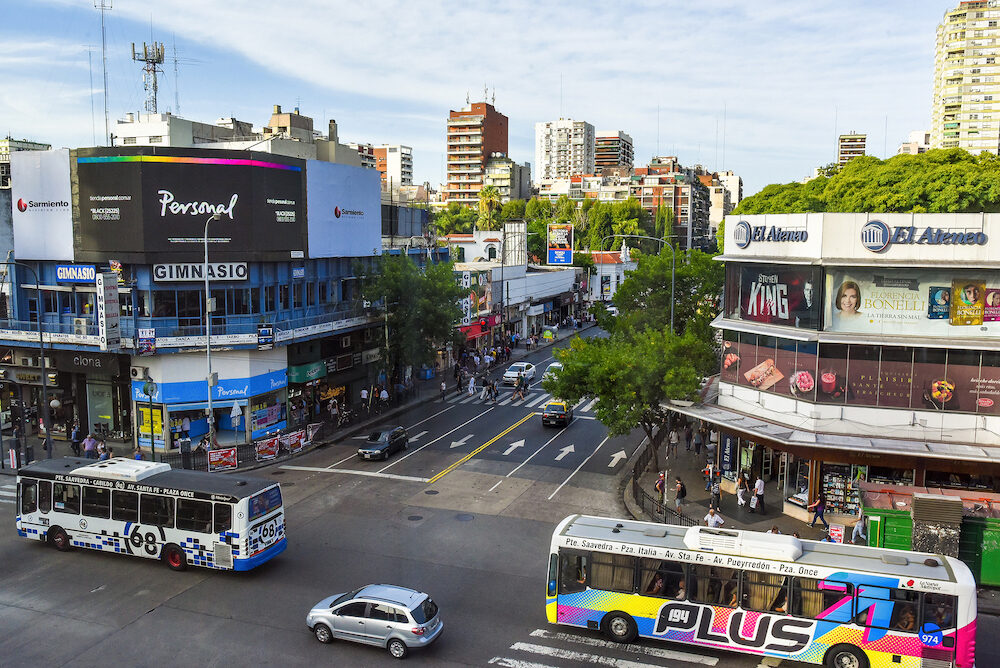 Buenos Aires Argentina - Aerial daytime view of the Cabildo Avenue with buses and pedestrians.