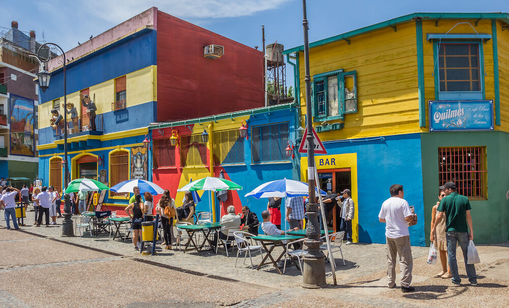 BUENOS AIRES, ARGENTINA - People on the the colorful streets of La Boca neighborhood in Buenos Aires, Argentina
