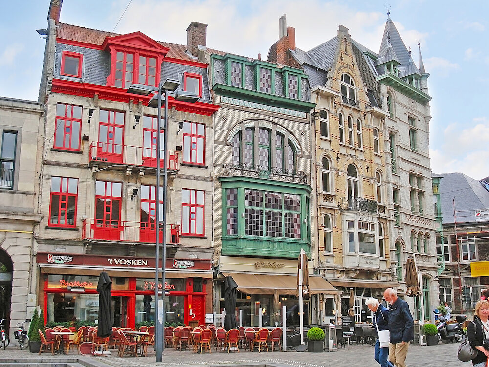 GHENT BELGIUM - Sint-Baafsplein Square is full of tourist cafes and luxury restaurants to spend the time in city center and enjoy the local cuisine in Ghent.