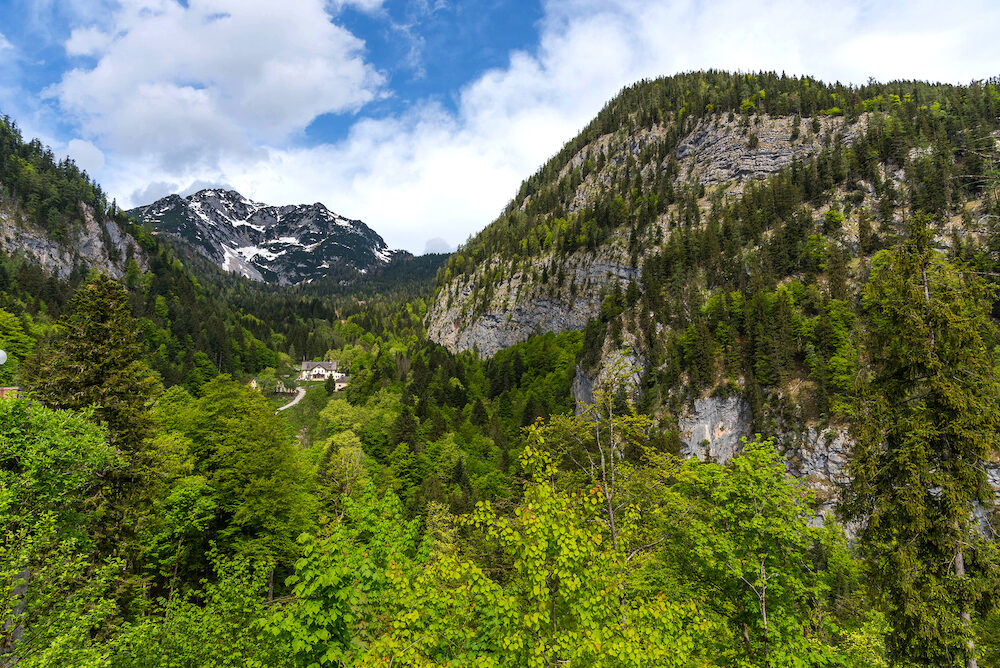Salt mine in Hallstatt in Austria is surrounded by mountains and beautiful and colorful trees in summer