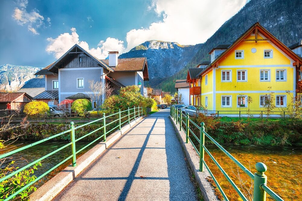 Scenic view of famous Hallstatt mountain village with Hallstatter lake.Typical Austrian Alpine houses with bright flowers. Location: resort village Hallstatt, Salzkammergut region, Austria, Alps. Europe.