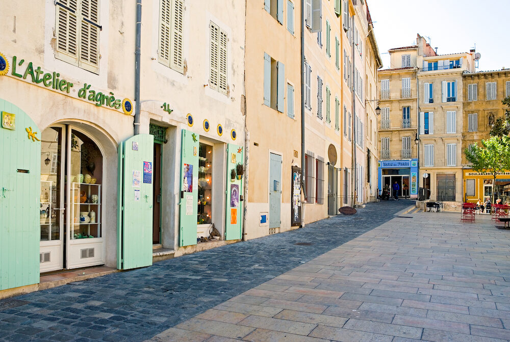 Marseille France -  People and traditional stores in the main square of the old district Le Panier