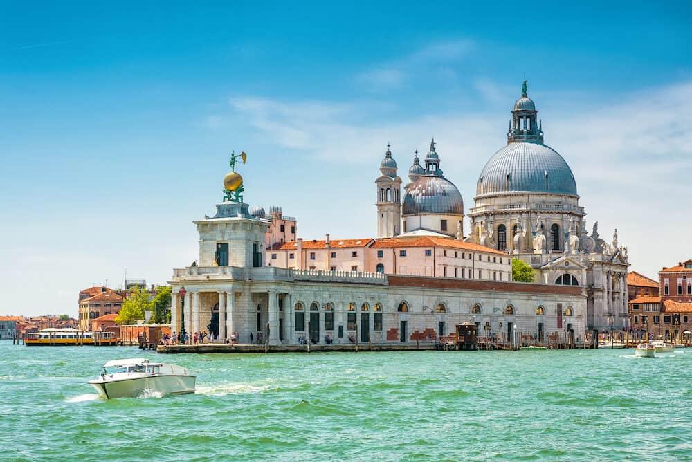Venice in summer, Italy. Grand Canal, Punta della Dogana and Basilica di Santa Maria della Salute. Venice landmarks. Postcard of Venice. Beautiful sunny view of Venice.