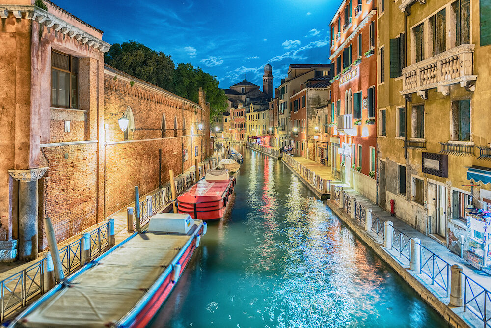 View over a picturesque canal at night in Santa Croce district of Venice, Italy