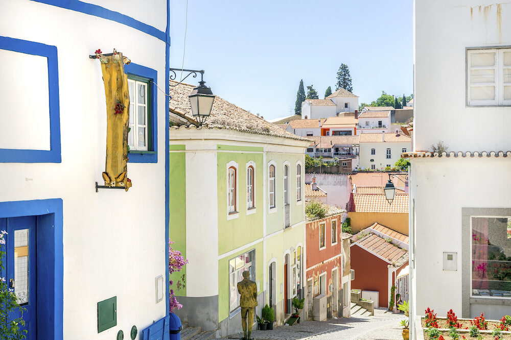Colorful facades of small portuguese houses in picturesque Monchique, Algarve, Portugal