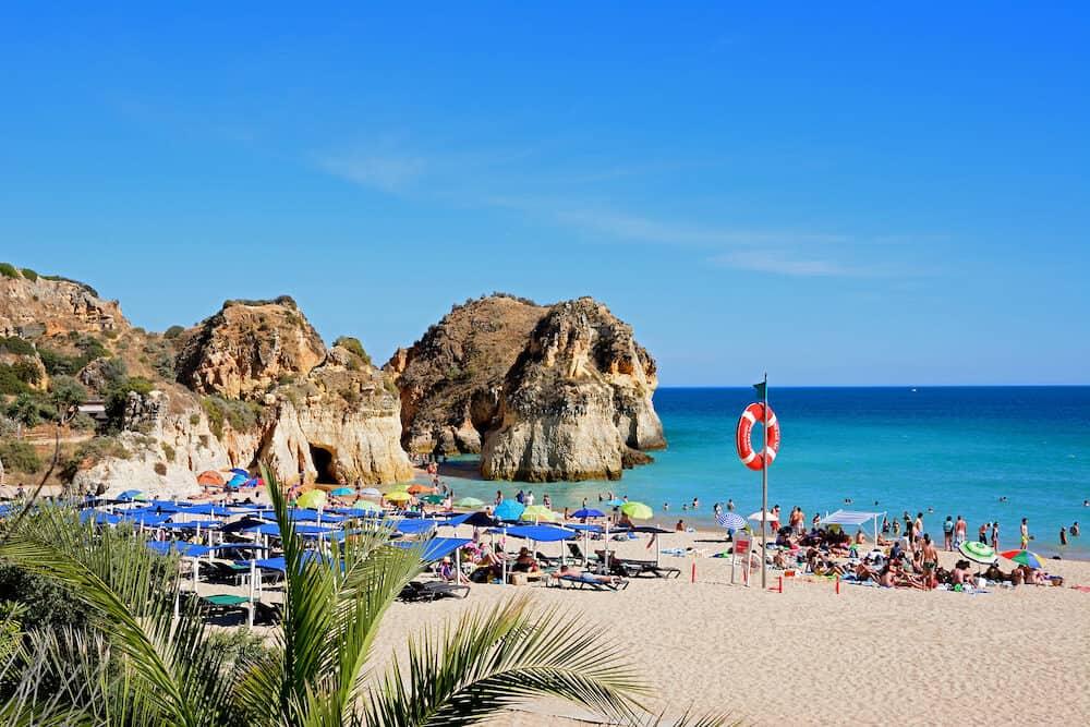 PORTIMAO, PORTUGAL - - Tourists relaxing on the beach and in the sea, Praia da Rocha, Portimao, Algarve, Portugal, Europe,