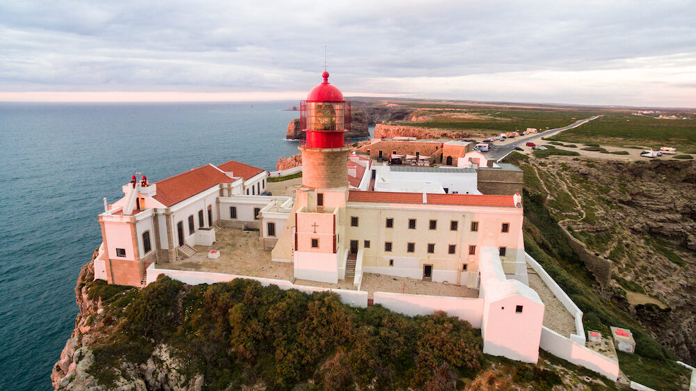 View of the lighthouse and cliffs at Cape St. Vincent at sunset. Continental Europe's most South-western point, Sagres, Algarve, Portugal.