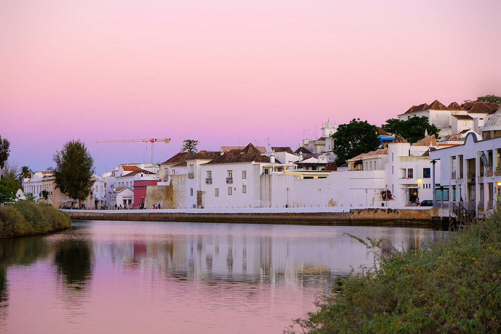 TAVIRA, ALGARVE, PORTUGAL - : View on the old city of Tavira with beautiful white houses and the river Gilao on the sunset.
