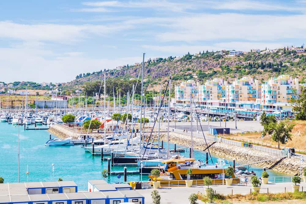 Vivid view of buildings and boats in the Porto de Abrigo de Albufeira, Albufeira Bay in Albufeira, Portugal