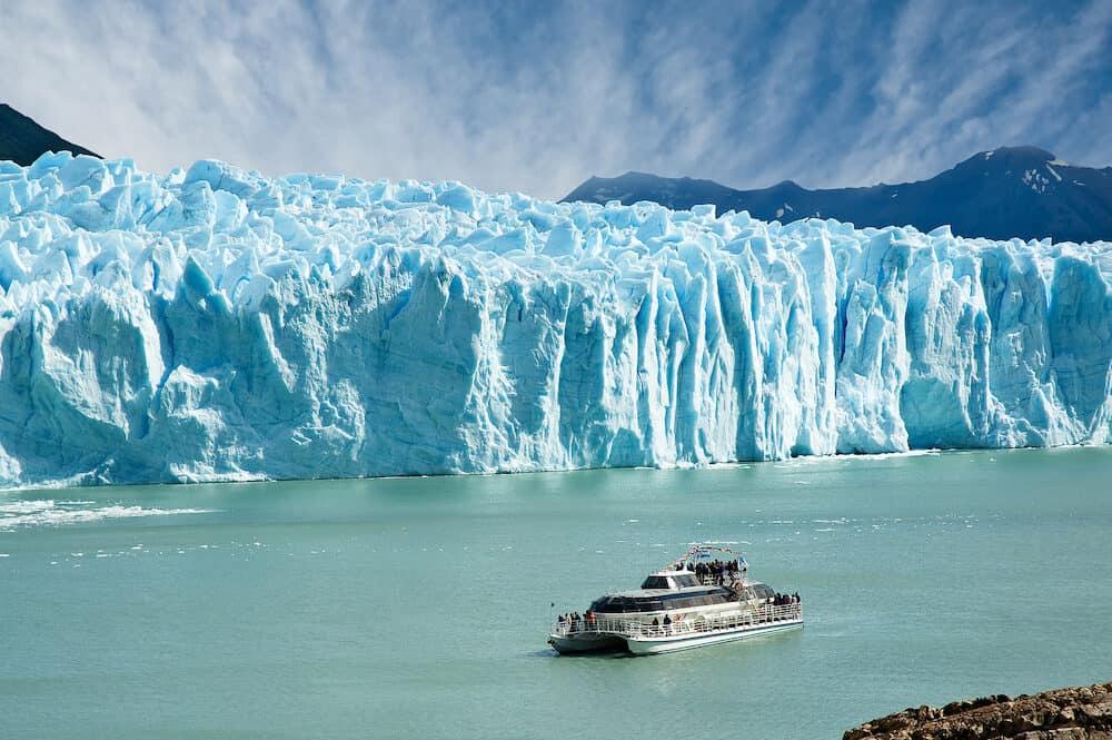 Boat sailing near Perito Moreno glacier in Patagonia Argentina.