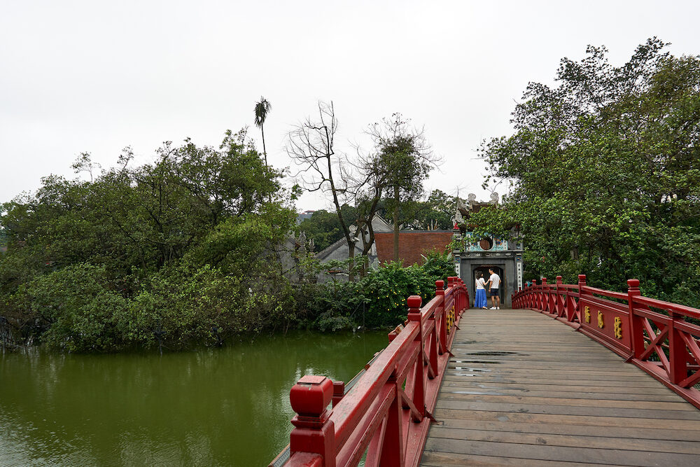 Hanoi, Vietnam - People visit Temple of the Jade Mountain on Hoan Kiem Lake in central Hanoi.