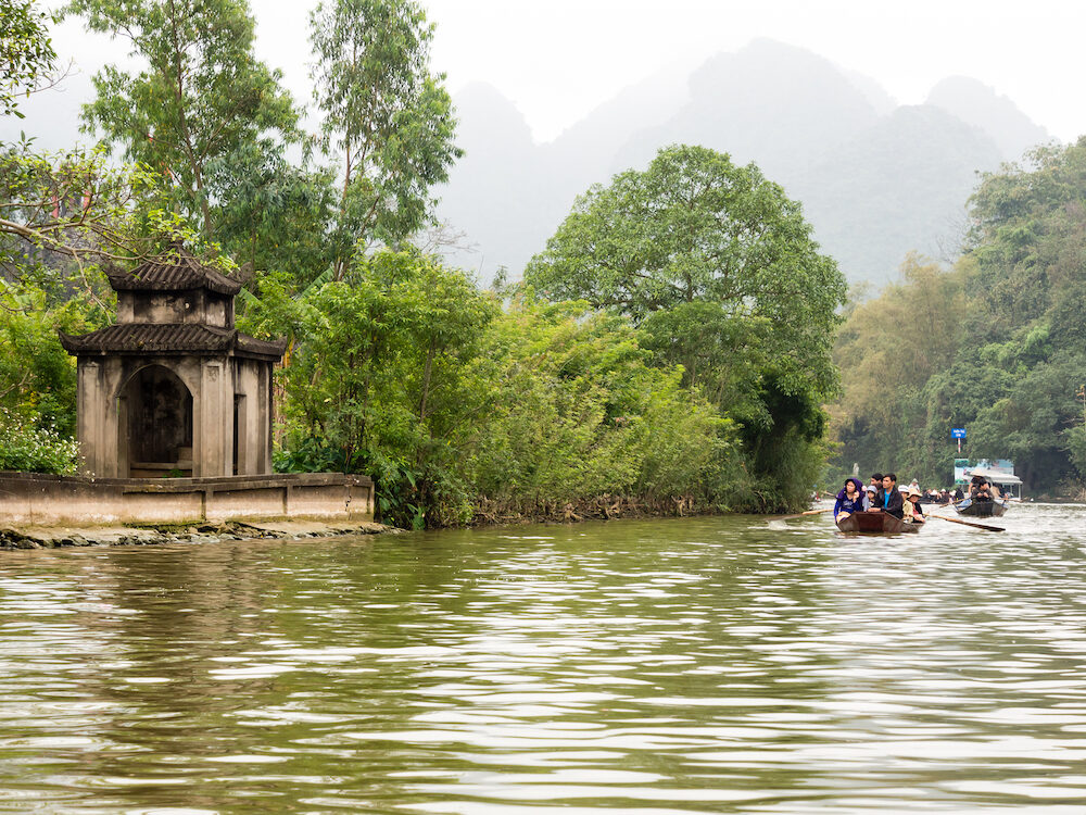 Huong Son, Vietnam - Tourist boats on the way to Perfume Pagoda, a popular day trip from Hanoi
