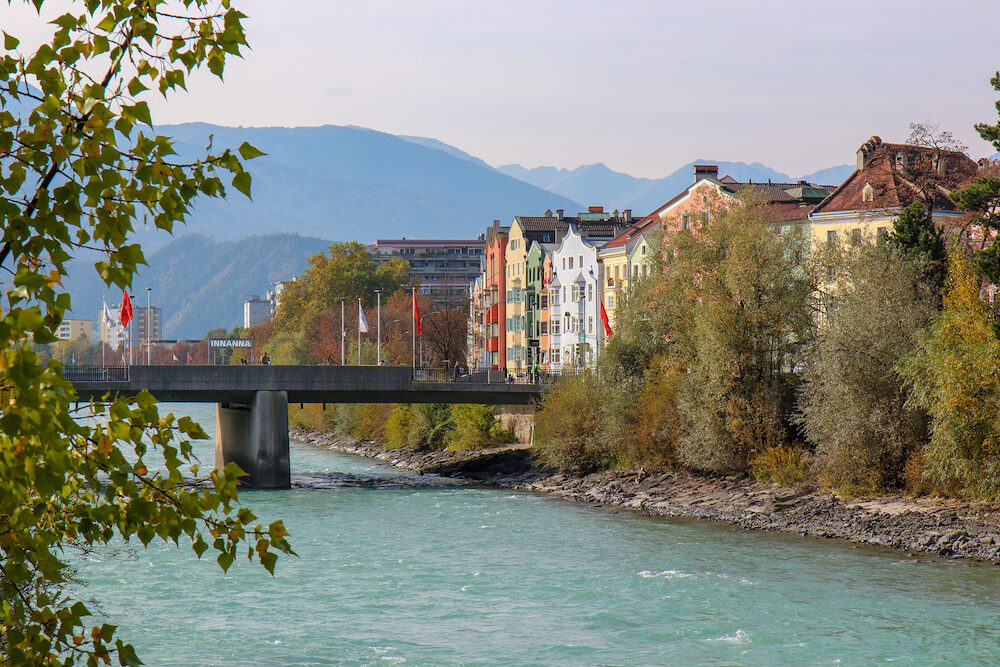 Innsbruck, Austria - Beautiful architecture in city center of the historic city center of Innsbruck with colorful houses along Inn river and famous Austrian mountain in the background - Innsbruck, Austria- Image