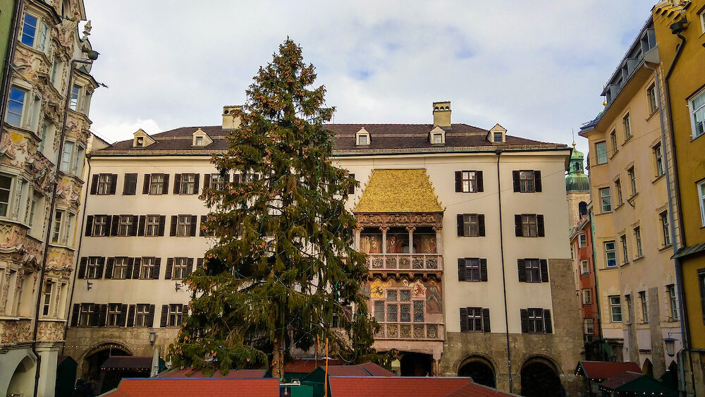 Traditional christmas market and tree near Goldenes Dachl (Golden roof) in the center of Innsbruck, Austria