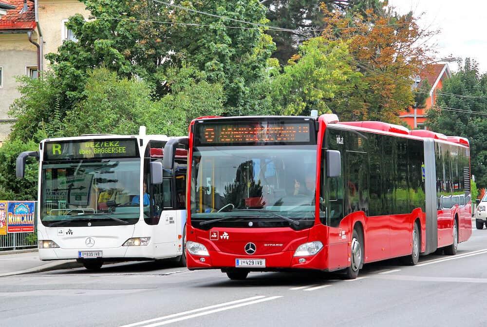 INNSBRUCK AUSTRIA - : Modern urban buses Mercedes-Benz O530 Citaro G at the city street.