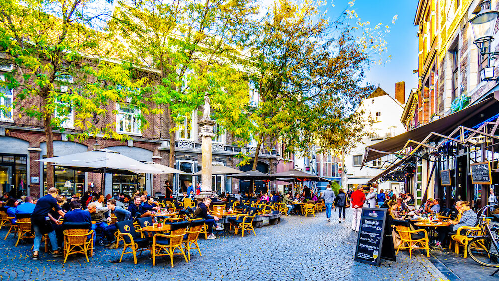 Maastricht, Limburg / the Netherlands - Many restaurant and pub terraces and patios to hang out with friends in the center of the historic city of Maastricht in the Netherlands