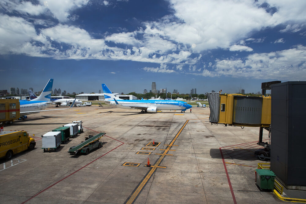 MENDOZA, ARGENTINA - Aircraft and ground vehicles manoeuvre on the tarmac at Mendoza Airport.