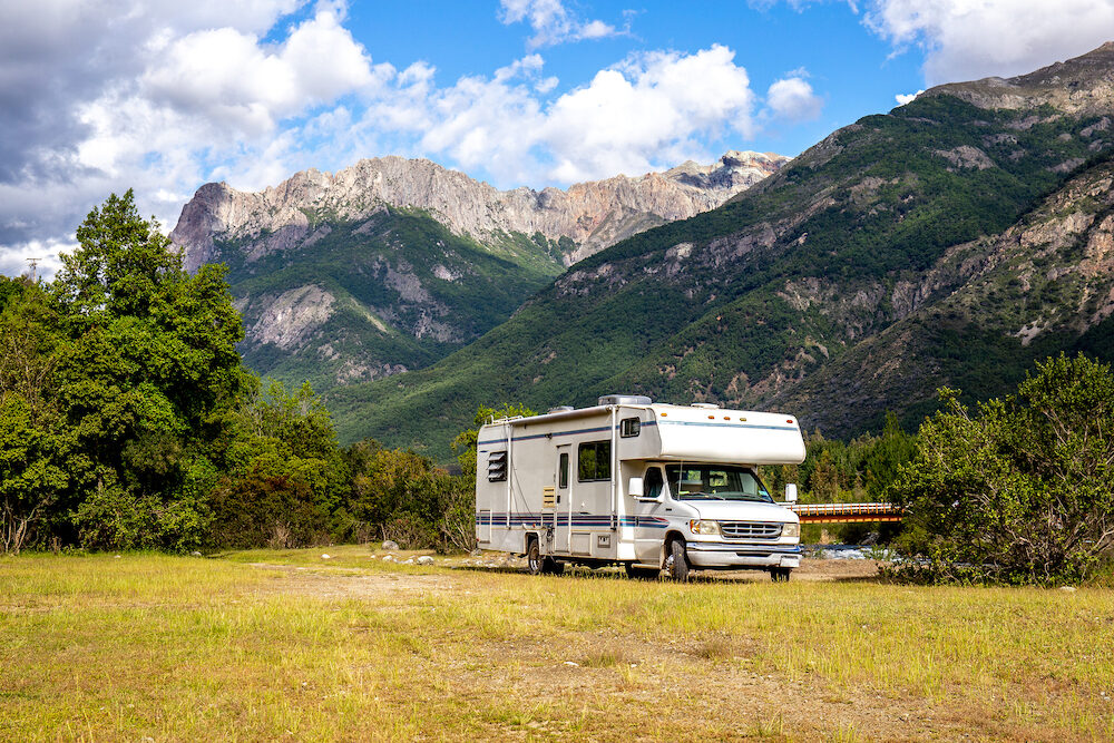 Panoramic view of MOTORHOME RV In Chilean landscape in Andes. Family trip traval vacation in mauntains