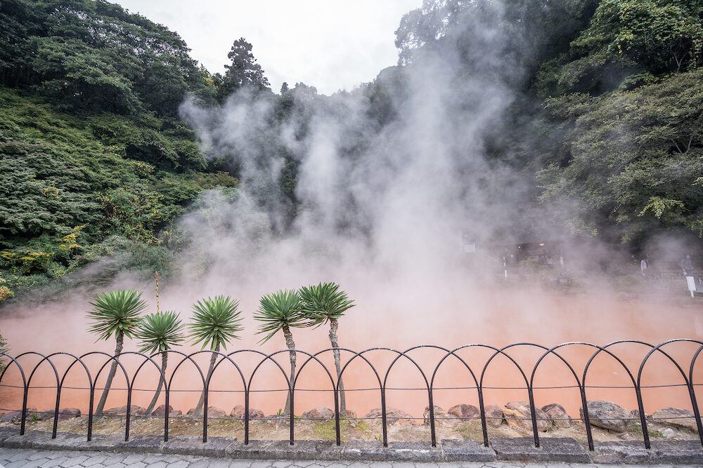 Beppu, Oita, Japan, Chinoike Jigoku (Blood Pond Hell) pond in autumn, which is one of the famous natural hot springs viewpoint, representing the various hells in Beppu