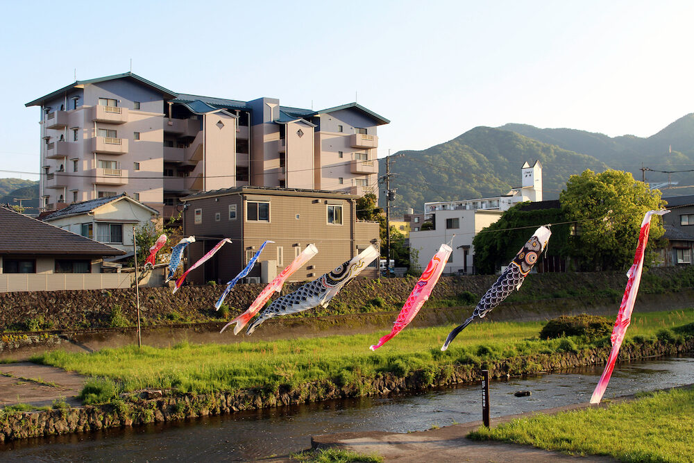 Japanese koinobori flying koi carp fish in Beppu during Golden Week. Taken in Oita,
