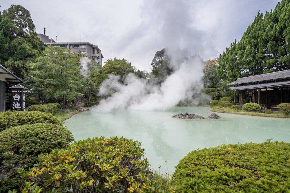 Beppu, Oita, Japan, Shiraike Jigoku (White pond Hell) pond in autumn, which is one of the famous natural hot springs viewpoint, representing the various hells in Beppu