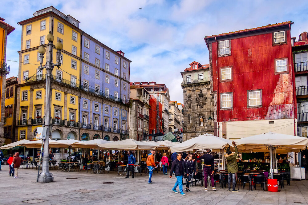 Porto, Portugal - Old town Ribeira promenade view and people